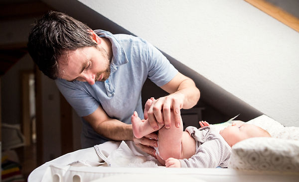 graphicstock-young-father-changing-nappy