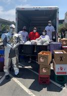 Staff & Volunteers unpacking groceries.p