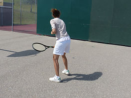 tennis player demonstrating a backhand basic stroke technique
