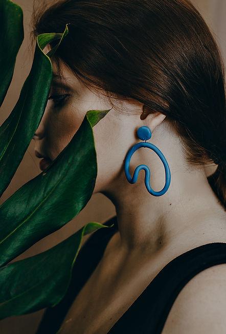 Canva - Photo of Woman Wearing Blue Earr