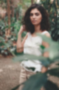 Canva - Woman Wearing Tank Top Standing