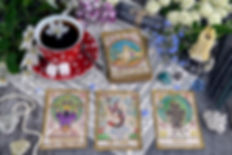 Tarot cards with cup of tea, flowers and