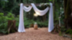 Wedding Ceremony Arch drape a Twin Willow Gardens