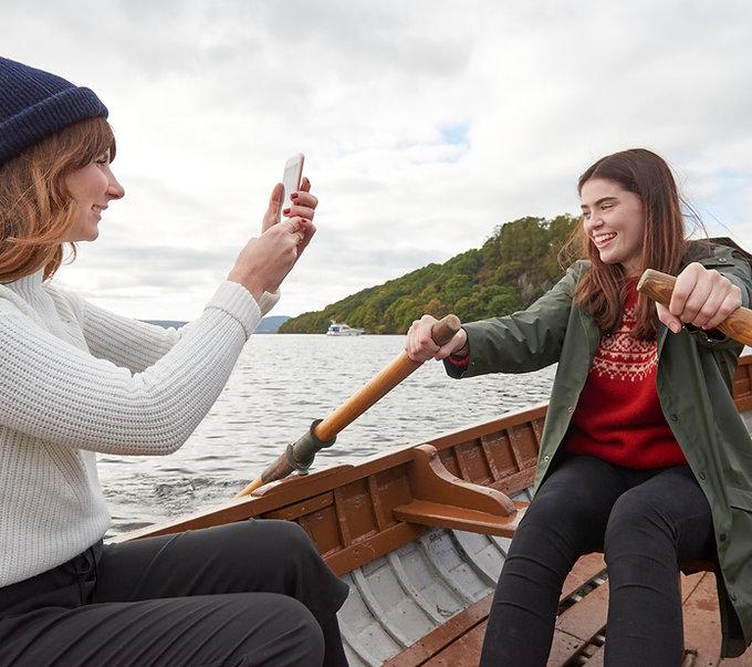 Friends Rowing a Boat