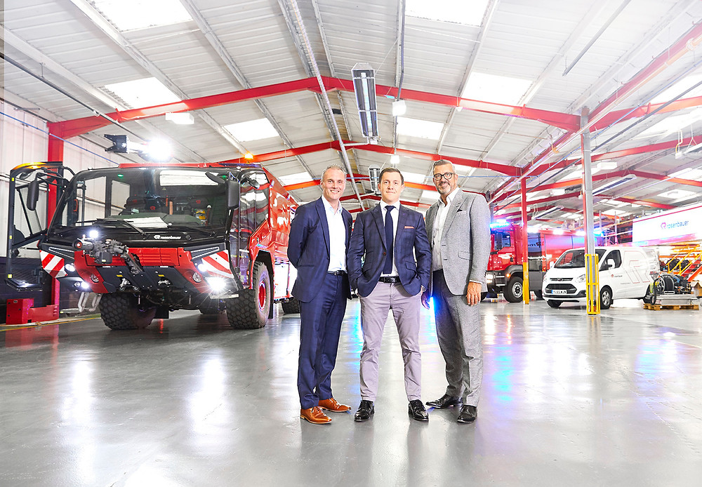 Huddersfield Town's Sean Jarvis and John Williams with Rosenbauer UK's Oliver North