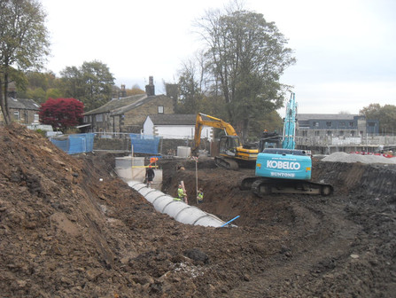 House builder invests £250k in flood defences for Huddersfield village