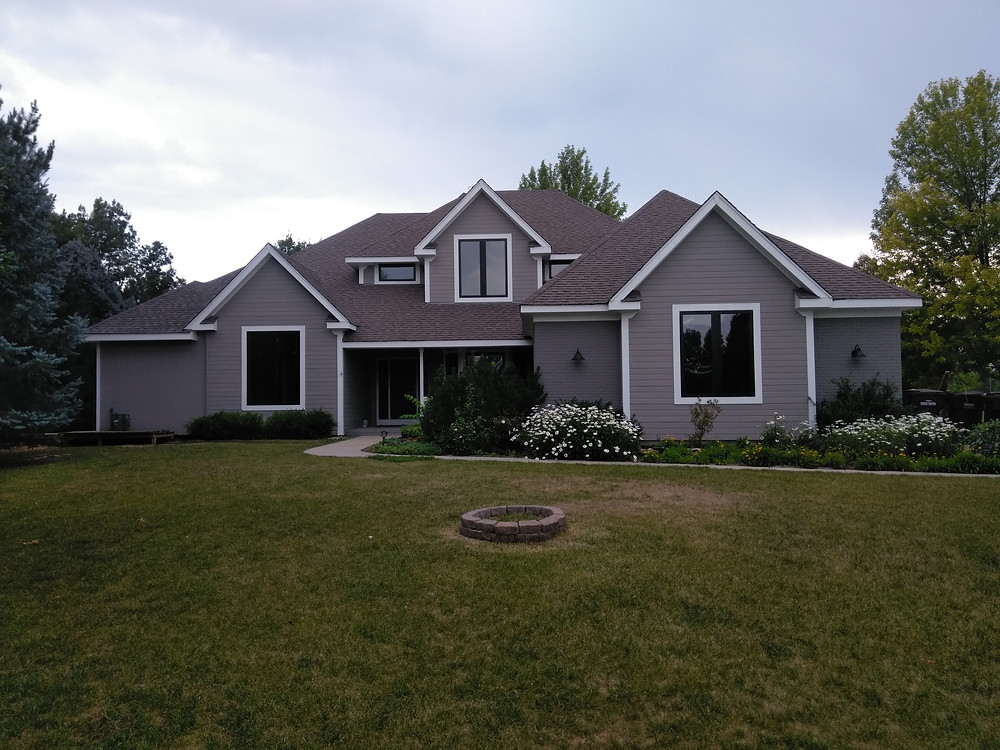 After Estes Park Colorado Painting Service Exterior Paint Contractor Exterior painting, staining, deck refinishing, Niwot Colorado near Longmont Colorado with Sherwin Williams Superpaint Paint, Powerhouse Caulking, Pressure washing