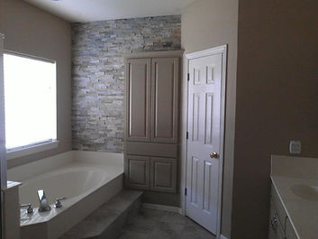 Bathroom Remodel After Painting, Texture wall paper removal, painting tape and bed in residental home in Estes Park Colorado Near Pinewood springs, niwot, Longmont, Loveland Colorado priming and painting home bathroom Ridgeline Paint Co Painting Company House Painter