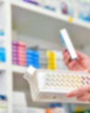1079270_pharmacist-choosing-medicine-ss-