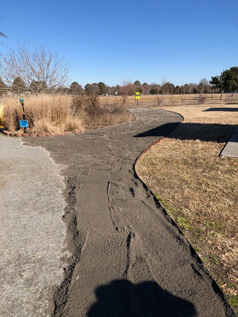 Here is the finished walkway.  It is our plan to install a narrow bed of native flowers along the outside edge.