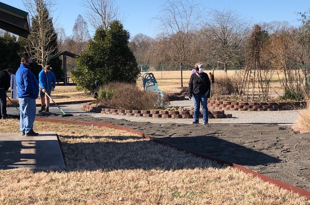 Grin & Grow Co-chair Sue Campbell surveys the new addition to the Learning Garden.