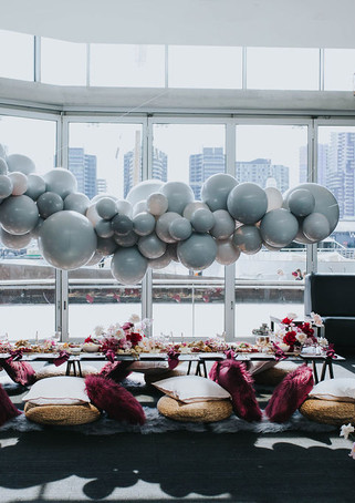 A custom grey balloon garland suspended above a picnic table. Jess's Bridal Shower Styled By Ruffles & Bells