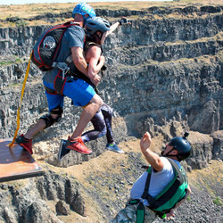 Parachute passenger does a tandem Base Jump in Idaho with highly experienced instructor