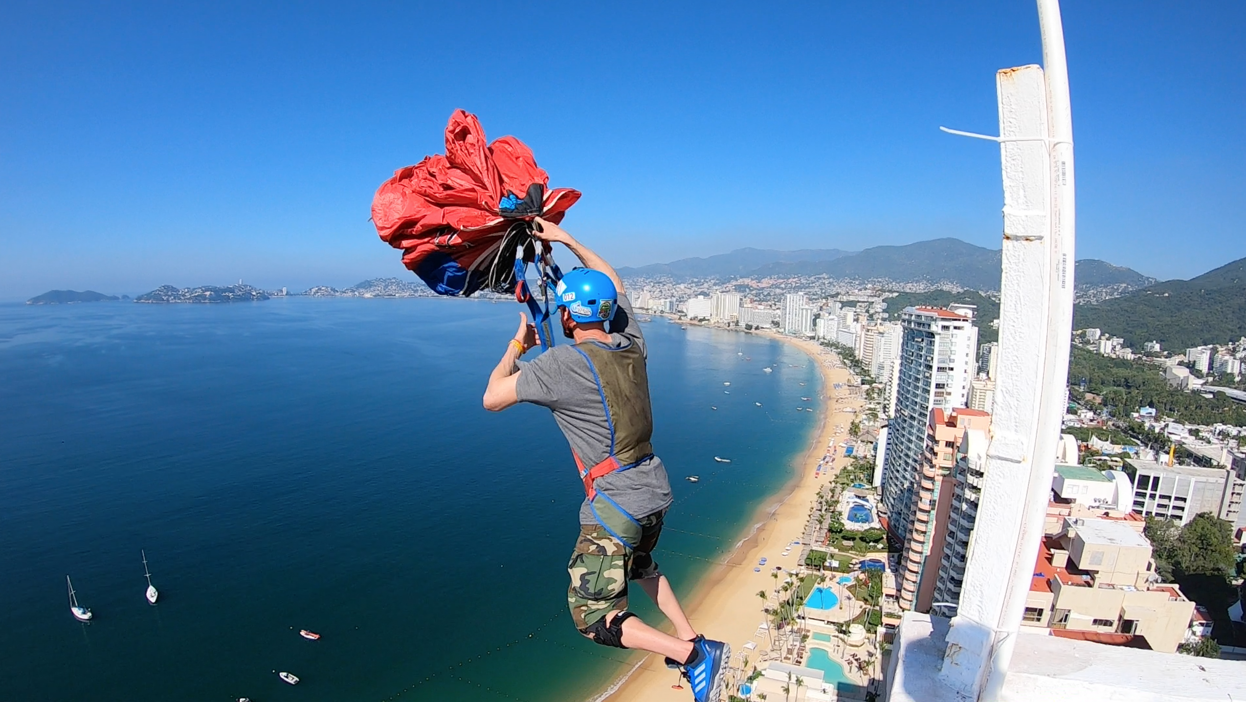 Sean Chuma performs an unpacked Base jump from a Building