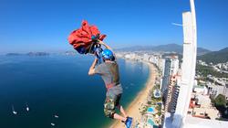 Sean Chuma performs an unpacked Base jump from a Building
