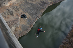 Base jumper jumping from Bridge