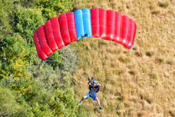 Base jumper turning around to say hello while flying