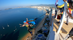 Tandem BASE Jumper is worlds first to jump all four objects.