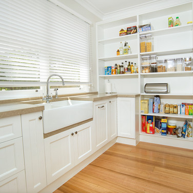 Fully functional butler's pantry, stone sink, traditional cabinetry hardware, floor to ceiling storage, appliance cupboard