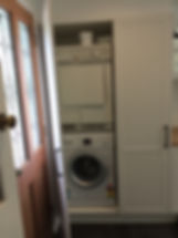 laundry with concealed washer/dryer combination; shaker style joinery; new exit point with stained timber leadlight door