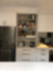 Haefle; Quantum Kitchens; applianc cupboard retractable doors; tinted mirror splashback