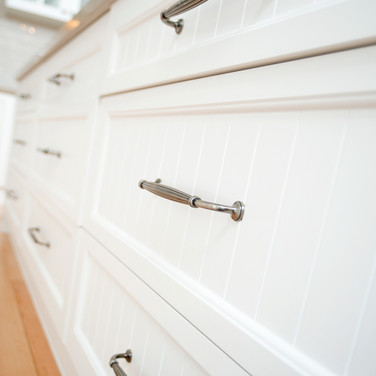 Country style cabinetry profile with traditional handles