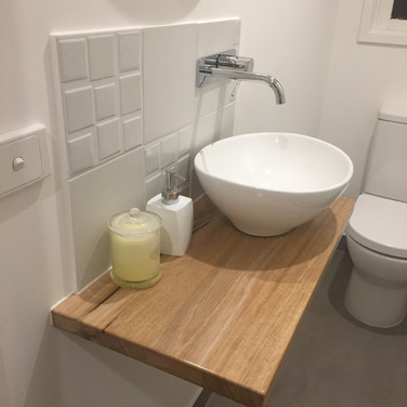 powder room redesign, feature tile splashback from Beaumont Tiles, wall mounted Phoenix tapware, floating timber benchtop