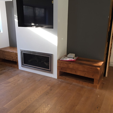 custom storage and seating made from recycled timber installed between new gas fireplace / TV wall, engineered timber flooring