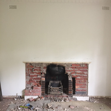 Demolished original art deco, double brick fireplace with gas insert.