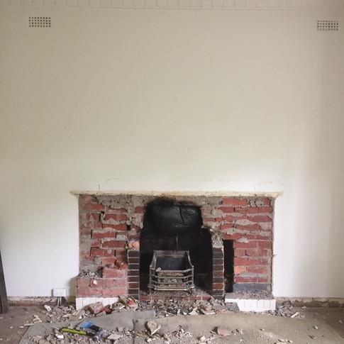 Demolished original art deco, double brick fireplace with gas insert.