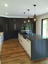 kitchen redesign; Raven Caesarstone; spotted gum solid flooring; modern cabinetry; industrial caged lighting about space
