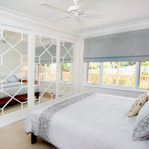 bedroom redesign, paintable wallpaper, fretwork mirrors, duck egg blue roman blinds