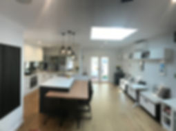 complete renovation; floating island vic ash dining table; wall hung storage seating; tinted mirror spashback; velux roof window; overhead lightng; black japan screns to zone spaces
