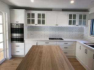 Hampton style kitchen; Mt Eliza renovation; subway tile + Misty grey contrast grout; blackbutt island bench showcasing feature island cabinetry.