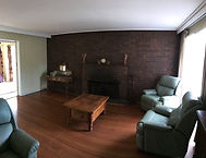 before photo of lounge space showing exposed dark brickwork, original open fireplace. See Gallery for after photos of this space.