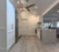 shaker style cabinetry; bianco drift caesarstone; matt classic white cabinetry; engineered flooring; perfect oak flooring; dulux natural white colour scheme