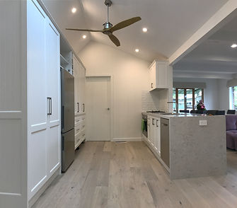 shaker style cabinetry; bianco drift caesarstone; matt classic white cabinetry; engineered flooring; perfect oak flooring; dulux natural white colour scheme