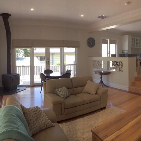 living room redesign, roman blinds, firebox, blonde furnishings