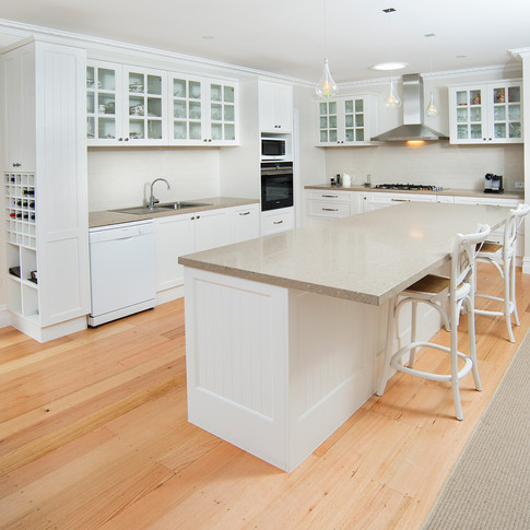 Kitchen redesign, country provincial kitchen design, caesarstone benchtop, feature panelling, feature display cupboards, integrated wine storage