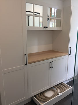 laundry joinery consisting classic white shaker style joinery, kicker drawer for additional storage; mirrored upper cupboards to enhance light and space; matte black cabinetry handles; Vic Ash timber benchtop