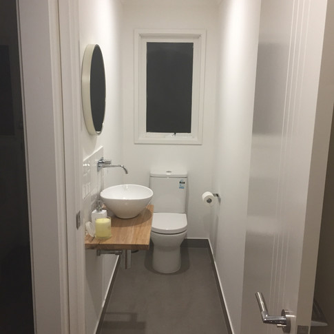 Powder Room redesign, floating timber bench, above mounted basin, wall mounted tapware, back to wall toilet