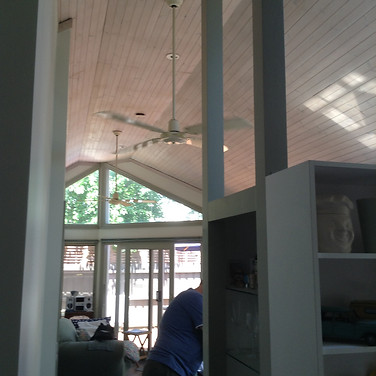 1990s original exension combining bathroom, laundry, kitchen and small living space, lining boards on ceiling