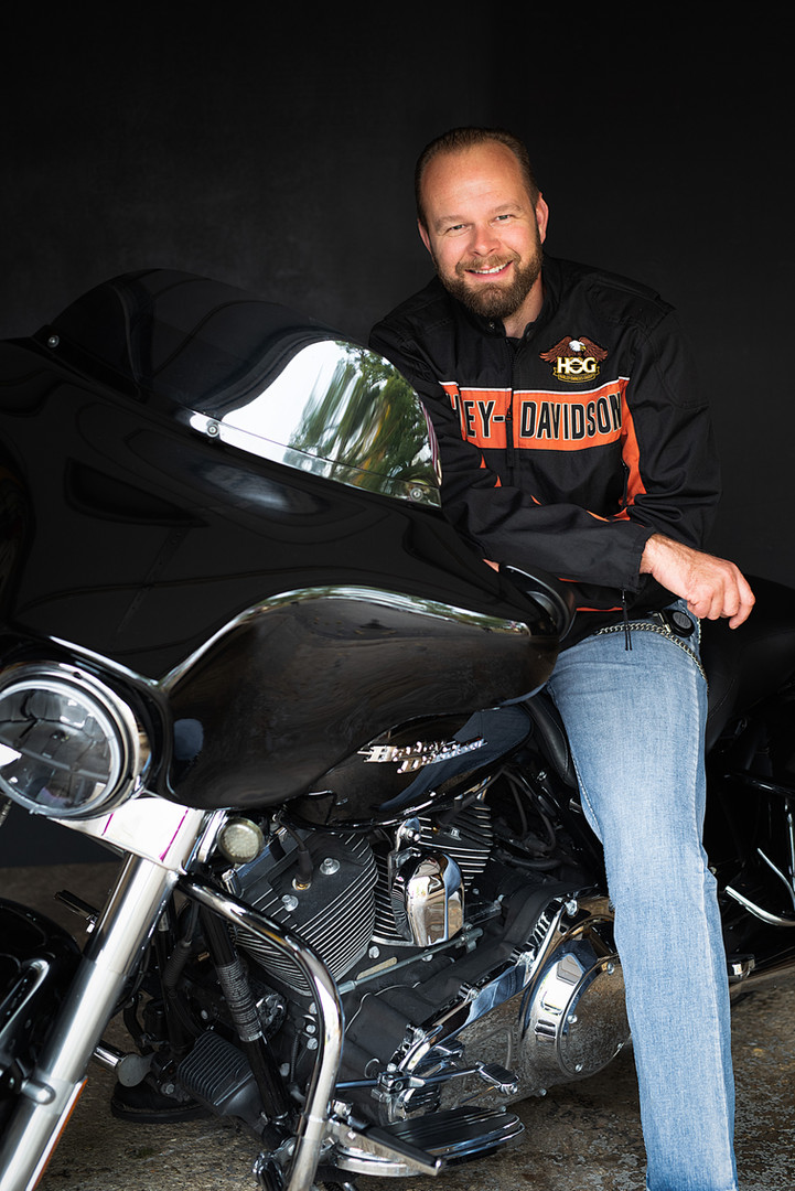 A man smiling on his Street Glide