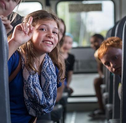 Children on the School bus - smiling gir