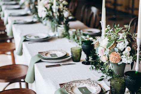 A beautiful dinner place setting with flowers for a catered wedding