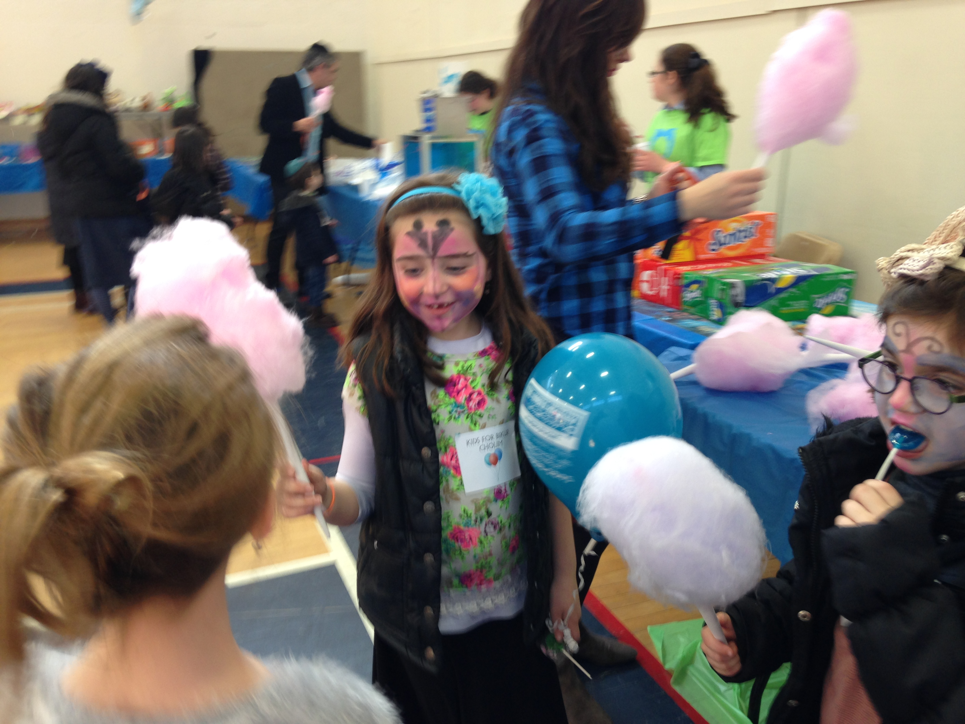 Girl with cotton candy painted face