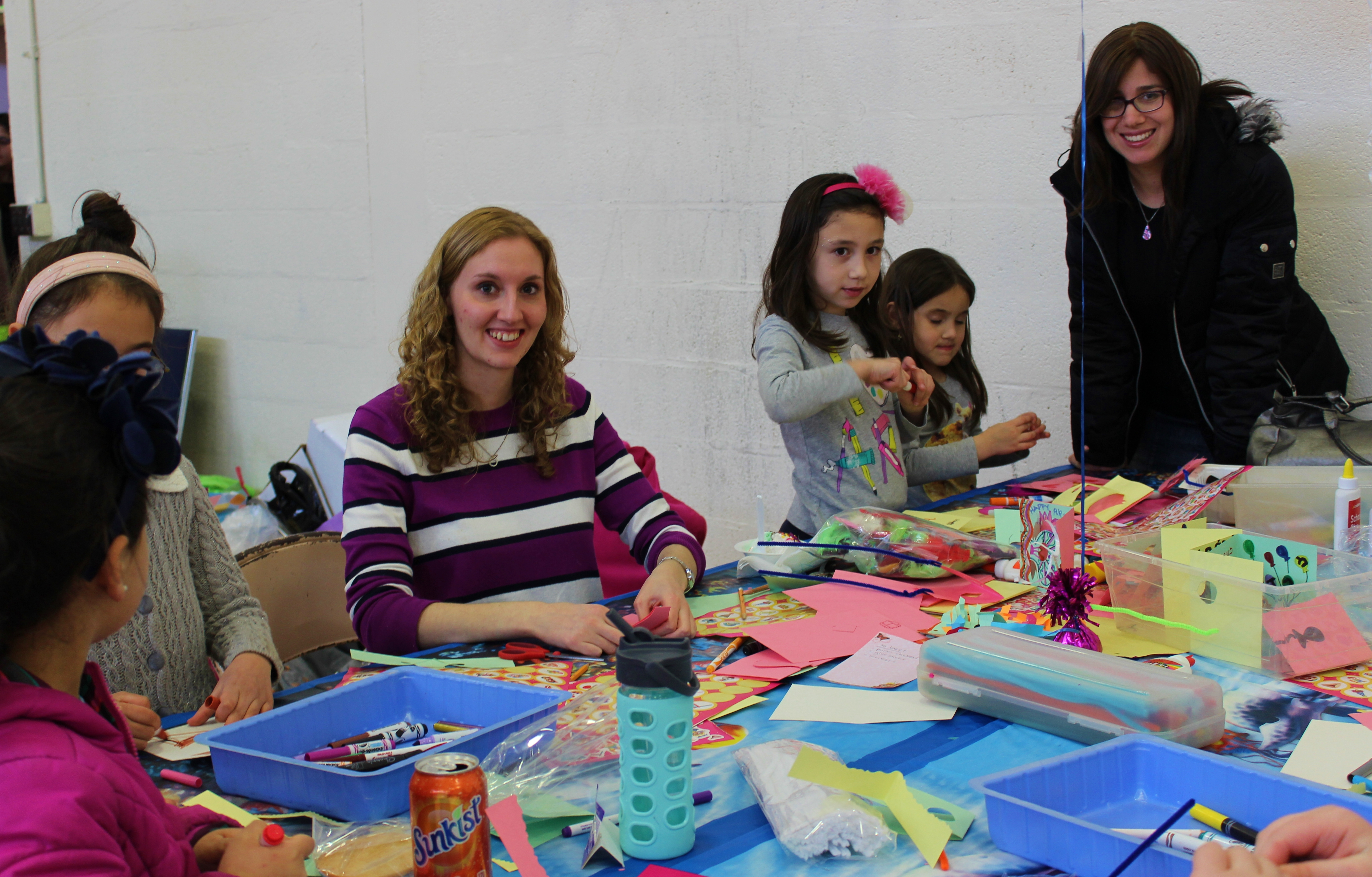 Smiling at the crafts table