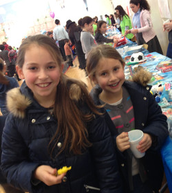 Sisters at prize table
