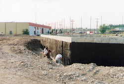 Covering the foundation with tar.