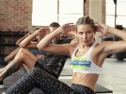 sports-bra-mockup-of-a-woman-doing-situps-in-a-fitness-class-38625-r-el2.png